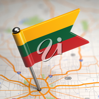 Small Flag of Lithuania Sticked in the Map Background with Selective Focus.