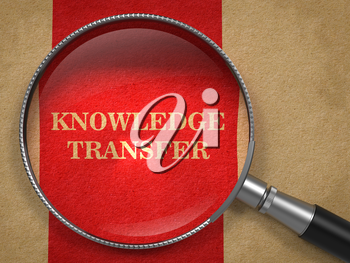 Knowledge Transfer Concept. Text on Old Paper with Red Vertical Line Background through Magnifying Glass.