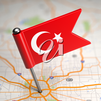 Small Flag of Turkey on a Map Background with Selective Focus.