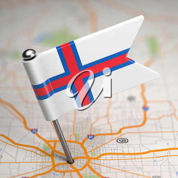 Small Flag of  Faroe Islands on a Map Background with Selective Focus.
