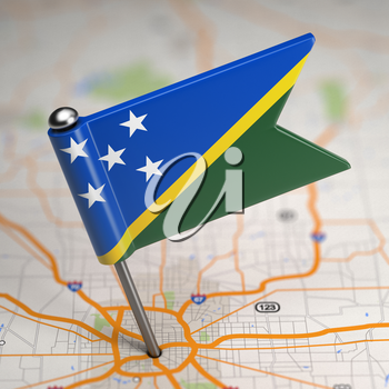 Small Flag of Solomon Islands on a Map Background with Selective Focus.