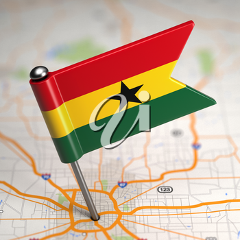 Small Flag of Ghana on a Map Background with Selective Focus.