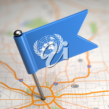Small Flag of United Nations on a Map Background with Selective Focus.