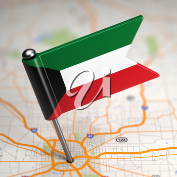 Small Flag of Kuwait on a Map Background with Selective Focus.