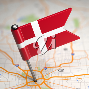 Small Flag of Denmark on a Map Background with Selective Focus.
