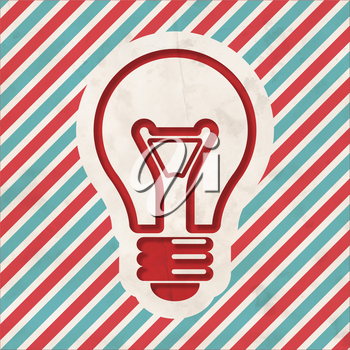 Light Bulb Icon on Red and Blue Striped Background. Vintage Concept in Flat Design.