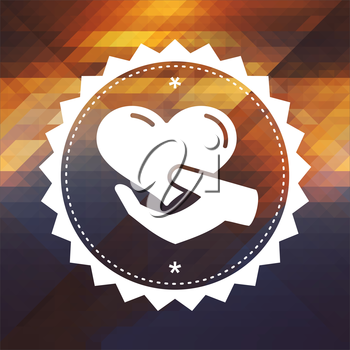 Charity Concept - Icon of Heart in the Hand. Retro label design. Hipster background made of triangles, color flow effect.