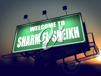 Welcome to Sharm el-Sheikh - Green Billboard on the Rising Sun Background.