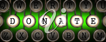 Donate Concept on Old Typewriter's Keys on Green Background.