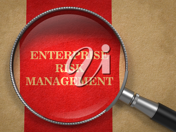 Enterprise Risk Management. Magnifying Glass on Old Paper with Red Vertical Line.