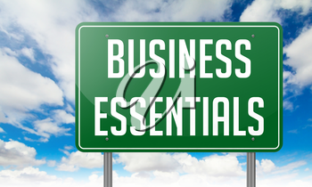 Highway Signpost with Business Essentials wording on Sky Background.