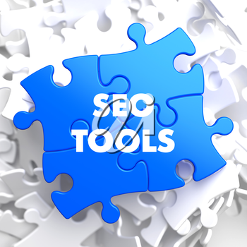 SEO Tools on Blue Puzzle on White Background.