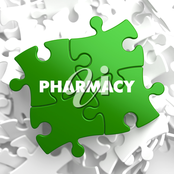 Pharmacy on Green Puzzle on White Background.