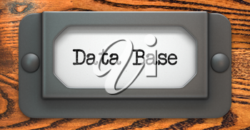 Data Base - Inscription on File Drawer Label on a Wooden Background.