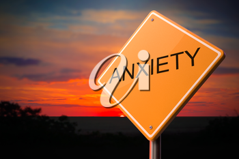 Anxiety on Warning Road Sign on Sunset Sky Background.
