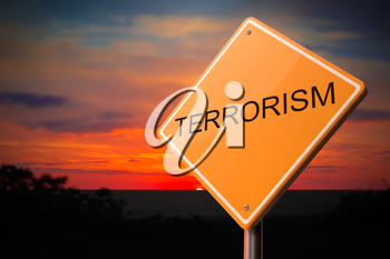 Terrorism on Warning Road Sign on Sunset Sky Background.