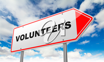 Volunteers - Inscription on Red Road Sign on Sky Background.