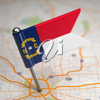 Small Flag of North Carolina on a Map Background with Selective Focus.