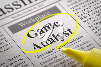 Game Analyst Vacancy in Newspaper. Job Seeking Concept.