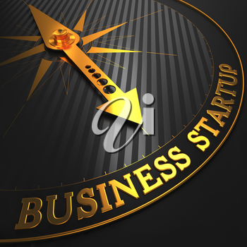 Business Startup - Golden Compass Needle on a Black Field.
