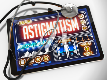 Astigmatism - Diagnosis on the Display of Medical Tablet and a Black Stethoscope on White Background.