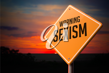 Sexism on Warning Road Sign on Sunset Sky Background.