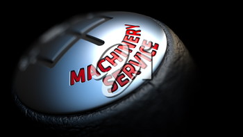 Machinery Service - Red Text on Car's Shift Knob on Black Background. Close Up View. Selective Focus.