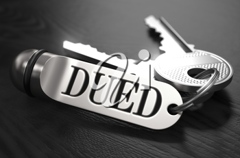DUED - Due Diligence - Concept. Keys with Keyring on Black Wooden Table. Closeup View, Selective Focus, 3D Render. Black and White Image.
