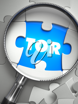 TOR - the Onion Router - Word on the Place of Missing Puzzle Piece through Magnifier. Selective Focus.