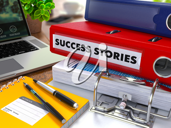 Red Ring Binder with Inscription Success Stories on Background of Working Table with Office Supplies, Laptop, Reports. Toned Illustration. Business Concept on Blurred Background.