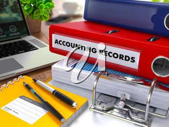 Red Ring Binder with Inscription Accounting Records on Background of Working Table with Office Supplies, Laptop, Reports. Toned Illustration. Business Concept on Blurred Background.