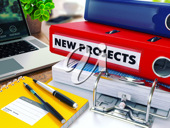 New Projects - Red Ring Binder on Office Desktop with Office Supplies and Modern Laptop. Business Concept on Blurred Background. Toned Illustration.