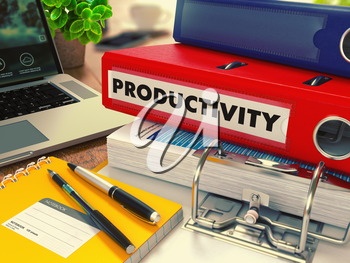 Red Office Folder with Inscription Productivity on Office Desktop with Office Supplies and Modern Laptop. Business Concept on Blurred Background. Toned Image.