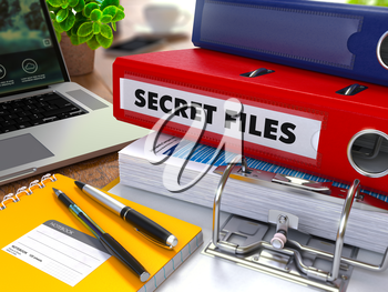 Red Ring Binder with Inscription Secret Files on Background of Working Table with Office Supplies, Laptop, Reports. Toned Illustration. Business Concept on Blurred Background.