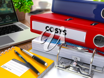 Red Ring Binder with Inscription Costs on Background of Working Table with Office Supplies, Laptop, Reports. Toned Illustration. Business Concept on Blurred Background.