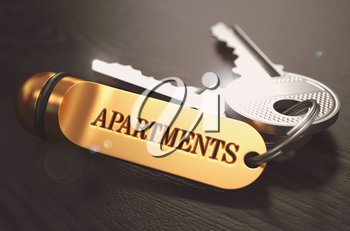 Keys with Word  Apartments on Golden Label over Black Wooden Background. Closeup View, Selective Focus, 3D Render. Toned Image.
