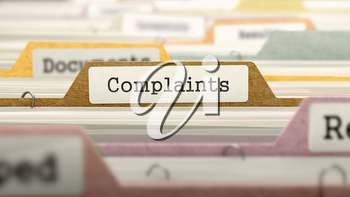 Complaints - Folder Register Name in Directory. Colored, Blurred Image. Closeup View.