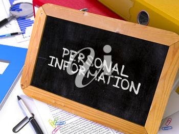 Personal Information Handwritten on Chalkboard. Composition with Small Chalkboard on Background of Working Table with Ring Binders, Office Supplies, Reports. Blurred Background. Toned Image.
