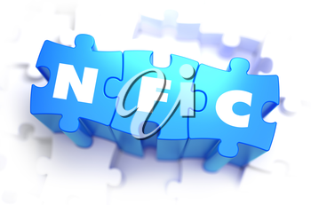 NFC - Near Field Communication - Text on Blue Puzzles on White Background. 3D Render.