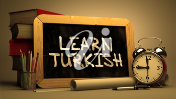 Hand Drawn Learn Turkish Concept  on Chalkboard. Blurred Background. Toned Image.