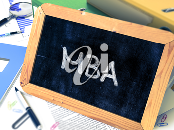MBA - Master Business Administration - Concept Hand Drawn on Chalkboard on Working Table Background. Blurred Background. Toned Image.