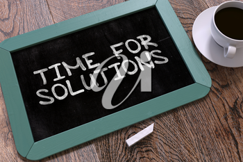 Hand Drawn Inspirational Quote - Time for Solutions - on Small Blue Chalkboard. Business Background. Top View.
