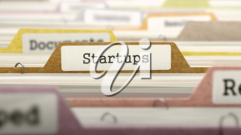 Startups Concept on Folder Register in Multicolor Card Index. Closeup View. Selective Focus.