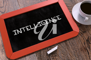 Intelligence Concept Hand Drawn on Red Chalkboard on Wooden Table. Business Background. Top View.