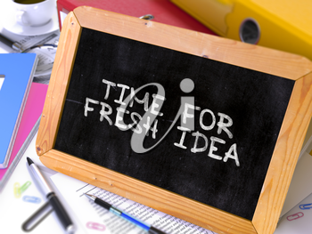 Time for Fresh Idea Handwritten by White Chalk on a Blackboard. Composition with Small Chalkboard on Background of Working Table with Office Folders, Stationery, Reports. Blurred, Toned Image.