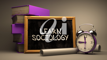 Hand Drawn Learn Sociology Concept  on Chalkboard. Blurred Background. Toned Image.