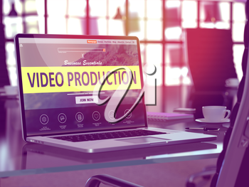 Video Production Concept. Closeup Landing Page on Laptop Screen  on background of Comfortable Working Place in Modern Office. Blurred, Toned Image.