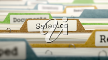 Salaries on Business Folder in Multicolor Card Index. Closeup View. Blurred Image.