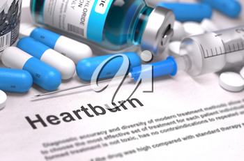 Diagnosis - Heartburn. Medical Concept with Blue Pills, Injections and Syringe. Selective Focus. Blurred Background.