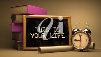 This is Your Life Handwritten by white Chalk on a Blackboard. Composition with Small Chalkboard and Stack of Books, Alarm Clock and Rolls of Paper on Blurred Background. Toned 3d Illustration.